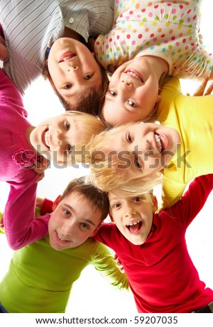 Image of happy kids embracing and laughing in circle