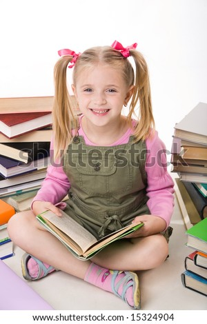 Image of happy pretty girl sitting and holding book