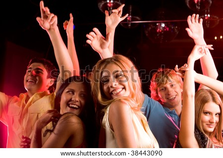 Image of happy young people having fun at disco