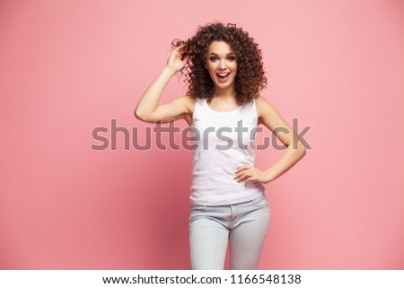 Image of happy young woman standing isolated over pink background. Looking camera pointing. #1166548138