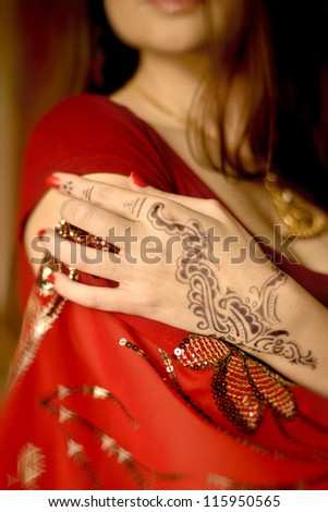 Image of henna on an Indian bride beautifully dressed - stock photo