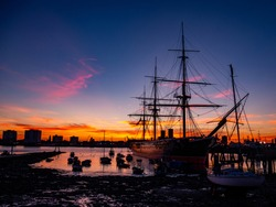 Image of HMS Warrior as sunset.