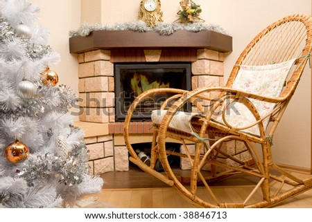 Image of house room with rocking-chair, Christmas tree, fireplace in it