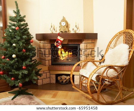 Stock Photo Image of house room with rocking-chair, Christmas tree, fireplace in it