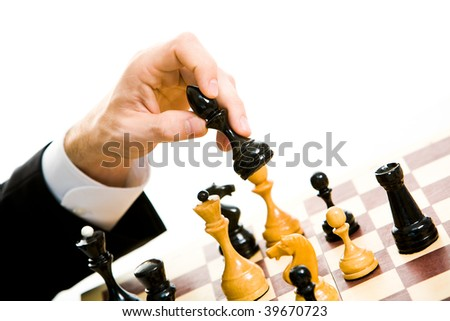 Image of human hand holding chess