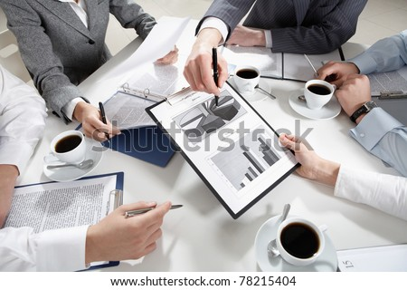 Image of human hands during discussion of business plans - stock photo
