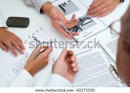Image of human hands during paperwork