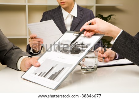 Image of human hands during paperwork at briefing