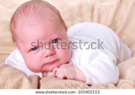 image of infant baby boy with gravity over light beige textured