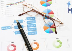 image of info graphics for business report with pen and calculator