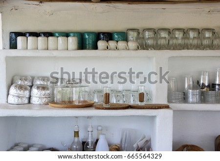 Image of interior decoration coffee shop has a lot of glass on the shelf
