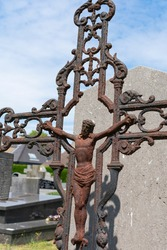 Image of Jesus Christ nailed to the cross, the cross is completely rusted