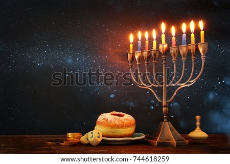 image of jewish holiday Hanukkah background with menorah (traditional candelabra) and burning candles