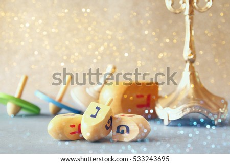 Image of jewish holiday Hanukkah with wooden dreidels colection (spinning top) - Shutterstock ID 533243695
