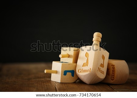 Image of jewish holiday Hanukkah with wooden dreidels colection (spinning top) on the table