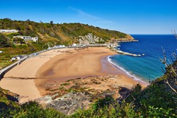 Image of La Greve de Lecq in the mornig sumer sunshine at low tide with sandy beach and clear water. Jersey, Channel Islands, Uk