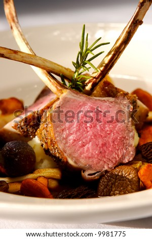 Image of lamb chops on a bed of vegetables