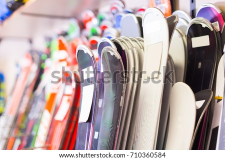 Image of large selection of skis in store. #710360584
