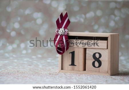 image of Latvian flag symbols on the calendar in honor of the declaration of independence of Latvia on November 18 #1552061420