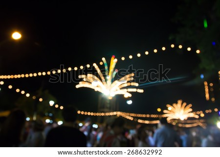 Image of  light  on street  with festive lights.blurred background