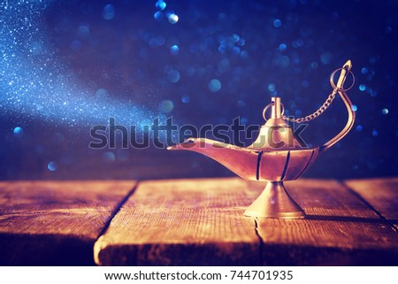 Image of magical aladdin lamp with glitter smoke. Lamp of wishes #744701935