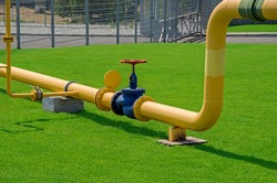 Image of main gas pipe valve overlap on background of green grass