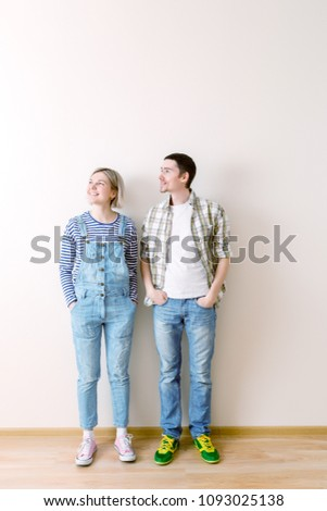 Image of man and woman in new empty apartment