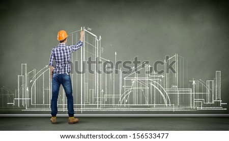 Image of man engineer against building project sketch