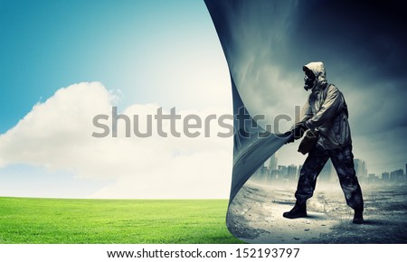 Image of man in gas mask turning page Ecology concept