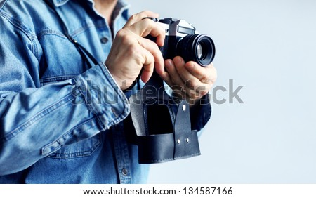 Image of man with retro camera