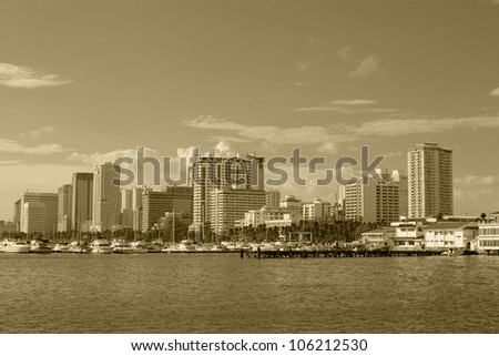 image of manila bay skyline during one hot afternoon.