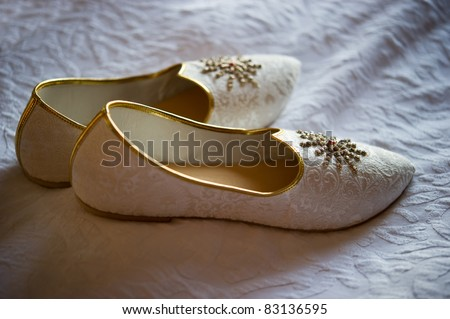stock photo Image of men 39s Indian wedding shoes on a bed