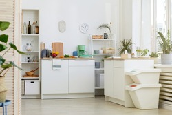 Image of modern kitchen with white furniture at house