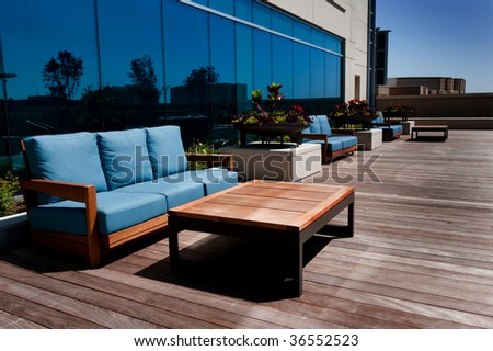 Image of modern outdoor furniture on wooden deck