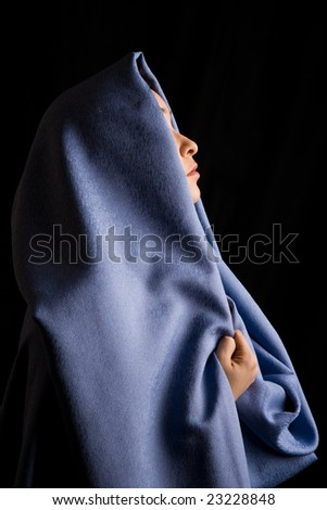 Image of moslem woman with blue fabric on her head
