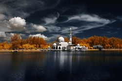 Image Of Mosque Tengku Tengah Zaharah Kuala Ibai Terengganu By The Lakeside Viewed In Infrared. custom white balance applied due to infrared image
