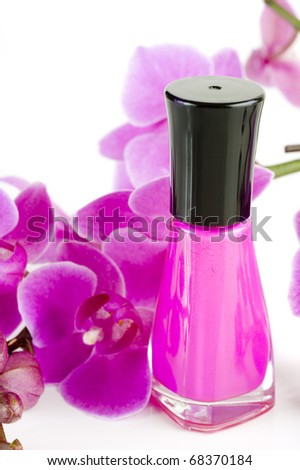 Image of nail polish with orchid in background
