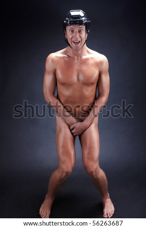 Image of naked man in hockey helmet over black background