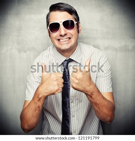 Image of nerd in short sleeved shirt and sunglasses giving a thumbs up