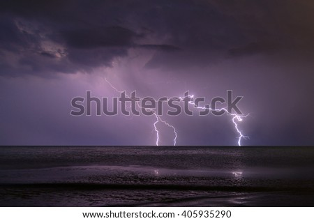 Stock Photo Image of night stormy sea with big waves and lightning
