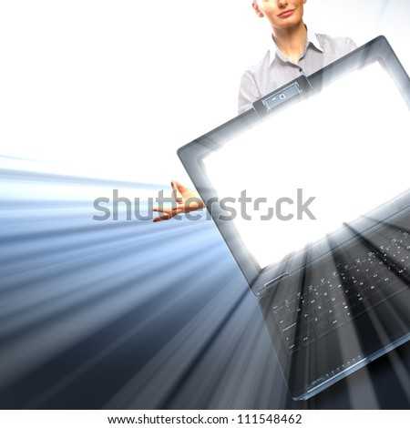 Image of notebook with shining screen and light