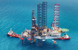 Image of oil platform while cloudless day,cross process tone.