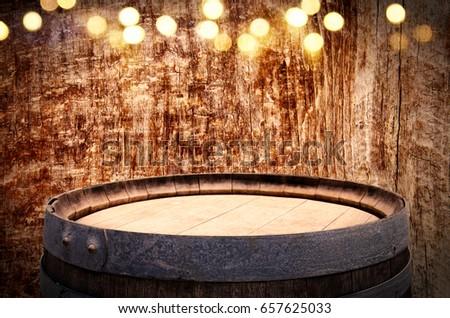 Image of old oak wine barrel in front of wooden background. Useful for product display montage. Vintage filtered #657625033