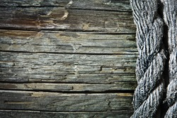 Image of old texture of wooden boards with ship rope