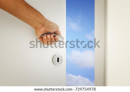image of open door to the blue sky. #729754978