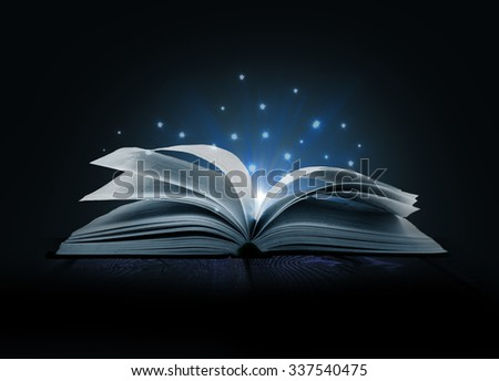 Image of opened magic book with magic lights #337540475