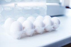 Image of package with ten white eggs
