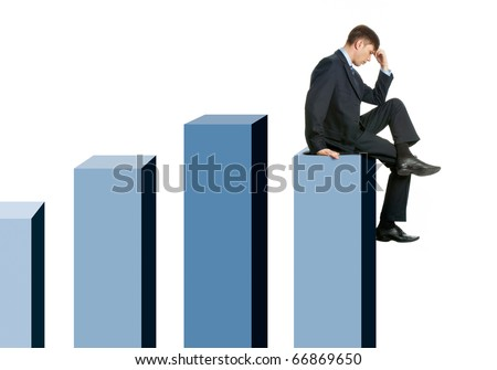 Image of pensive businessman sitting on chart columns