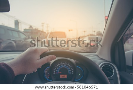 image of people driving car on day time for background usage.(take photo from inside focus on driver hand) #581046571