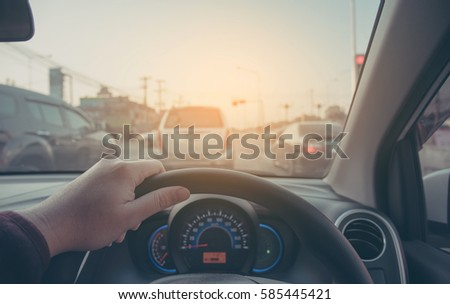 image of people driving car on day time for background usage.(take photo from inside focus on driver hand) #585445421